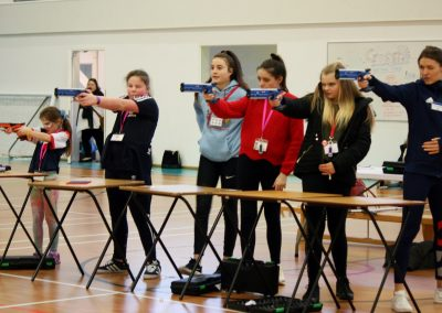 resize- Lasershooting - with girls, young volunteer and Kelly Massey (RR)